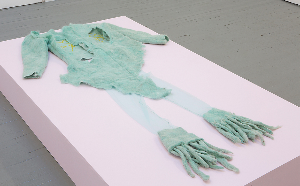 "Brook Hsu, Psychedelic Outfit (Sweatshirt and Bellbottoms), 2017, felted llama wool, mesh, wooden plinth, 2 x 48 x 84""."