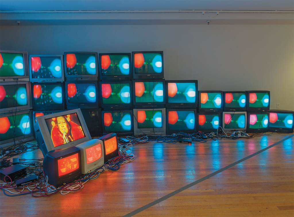Paul Stephen Benjamin, God Bless America, 2016, forty-six monitors with three-channel video (color, sound, indefinite duration). Installation view, 2017. Photo: Adam Reich.