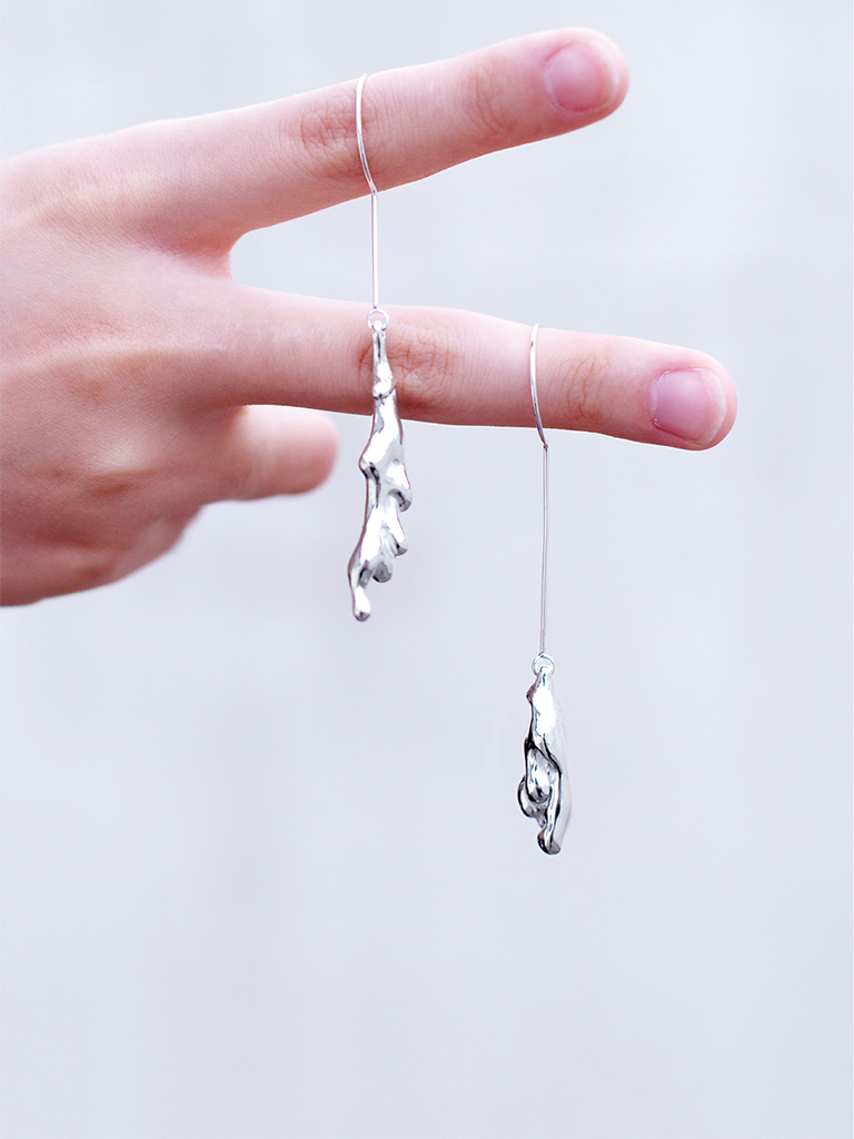 "*Seoul-Metal, Liquid Earrings_03, 2017*, silver, 3 1/8 × 3/8 × 3/8""."