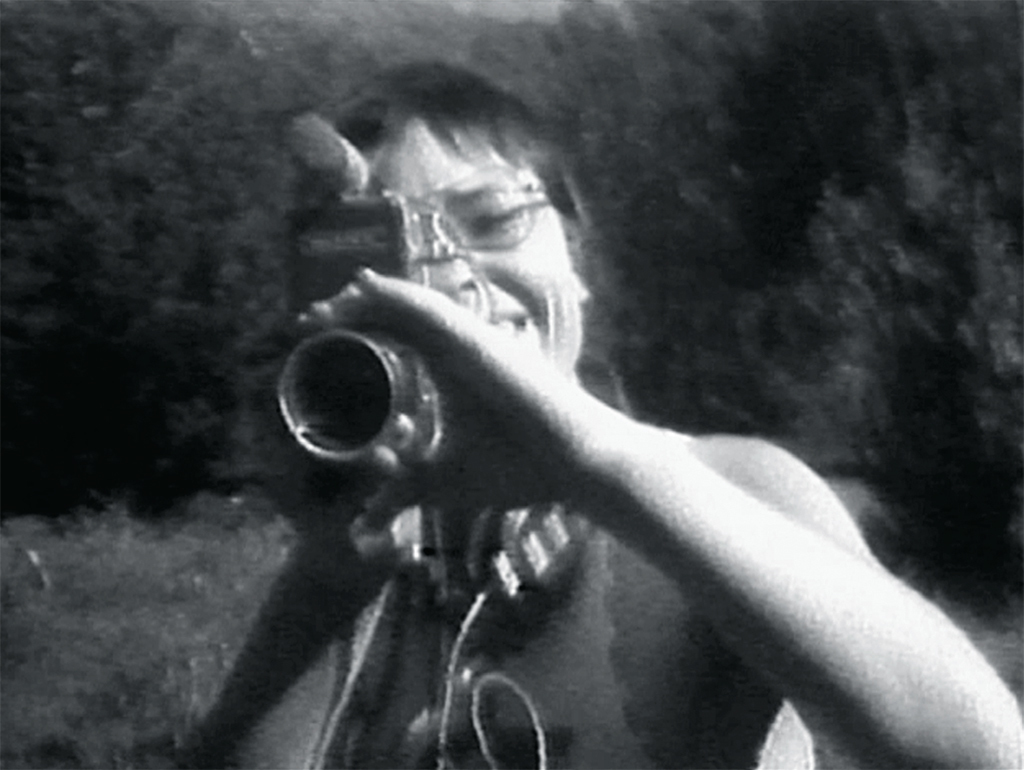 Still from Barbara Hammer and Max Almy's Superdyke Meets Madame X, 1975, video, black-and-white, sound,