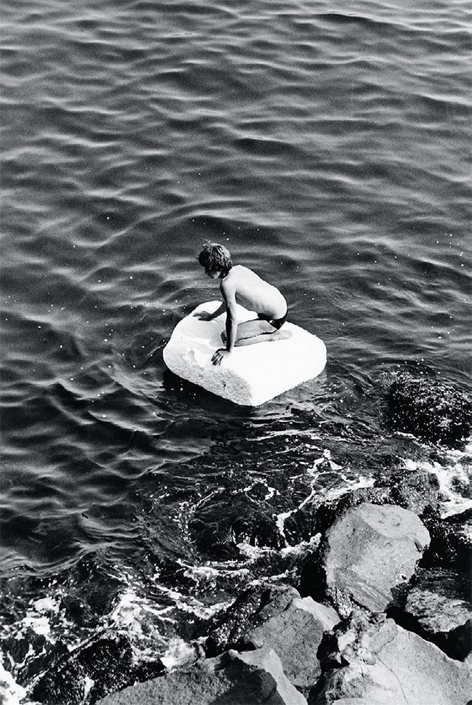"Peter Hujar, Boy on Raft, 1978, gelatin silver print, 14 x 11"". © Peter Hujar Archive, LLC."