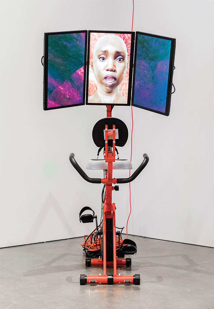 "Sondra Perry, Graft and Ash for a Three-Monitor Workstation, 2016, bicycle workstation, video, color, sound, 9 minutes 5 seconds. From ""Art in the Age of the Internet, 1989 to Today."" Photo: Caitlin Cunningham."