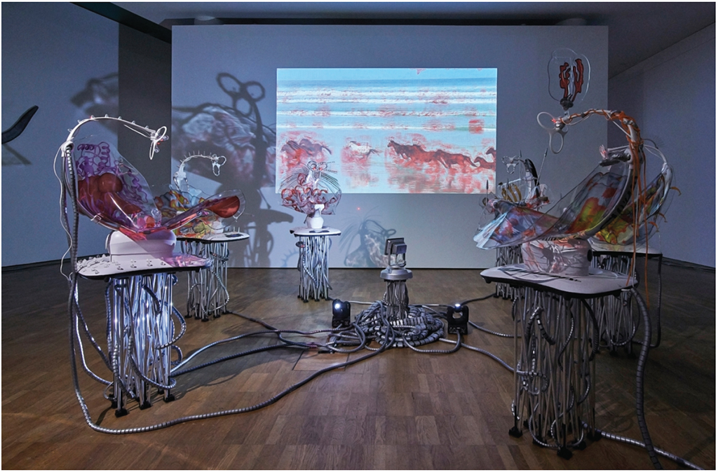 Katja Novitskova, Pattern of Activation (mamaRoo Nursery and Dawn Chorus), 2017, electronic baby swings, aluminum folding stands, lasers, digital print, robotic bugs, Swarovski crystals, stress pills, silicone stress eggs, acrylic massagers, animal-patterned stickers, fossils, tree mushrooms, video projection, and mixed media. Installation view. Photo: Tõnu Tunnel.