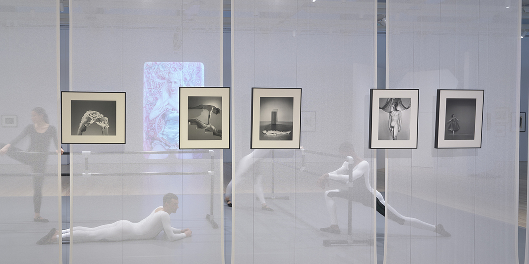 "View of ""Nick Mauss: Transmissions,"" 2018. Left to right, front: George Platt Lynes, Tex Smutney, 1941; George Platt Lynes, Paul Cadmus and Jared French (artists), 1937; George Platt Lynes, Laurie Douglas Harvach (model), 1944; George Platt Lynes, Nicholas Magallanes (dancer), c. 1938; George Platt Lynes, Diana Adams (dancer), 1951. Left to right, back (dancers): Kristina Bermudez; Brandon Collwes; Matilda Sakamoto; Quenton Stuckey. Photo: Ron Amstutz."