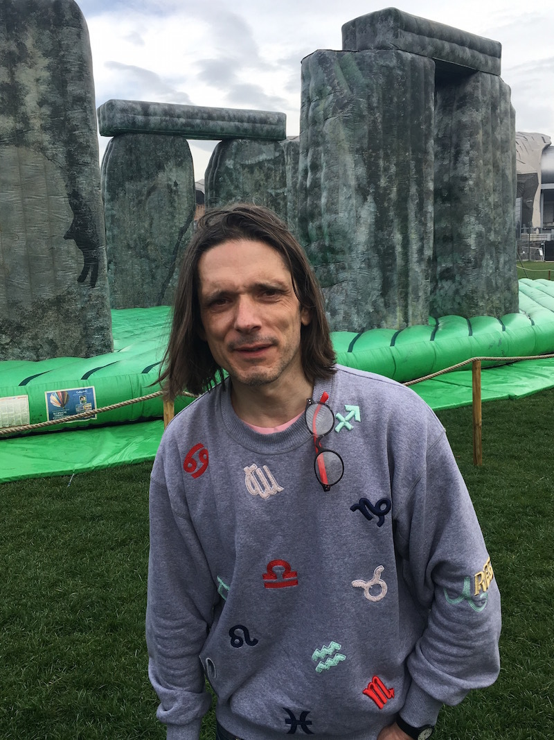Artist Jeremy Deller in front of his inflatable sculpture, Sacrilege, 2012.