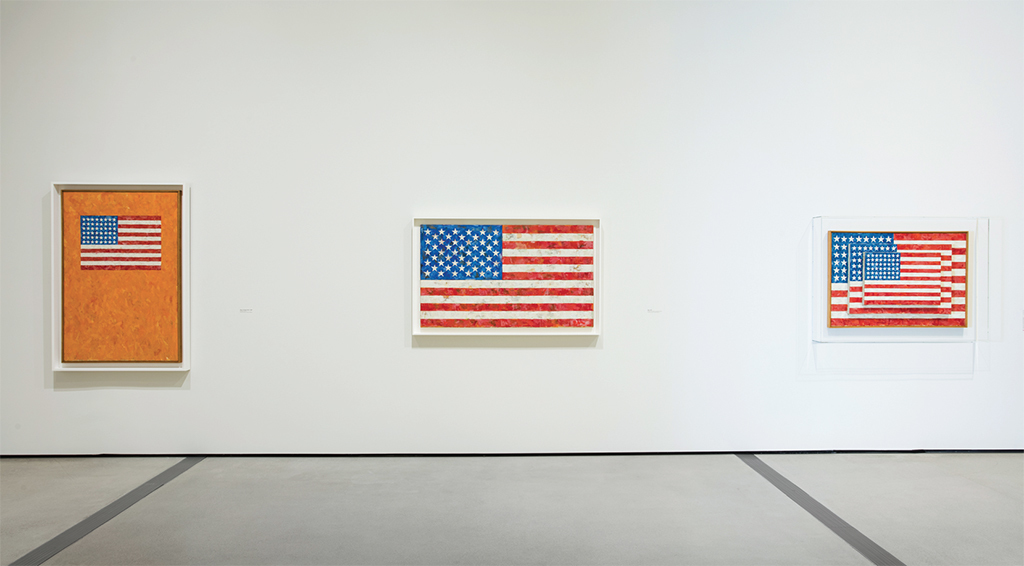 "View of ""Jasper Johns: Something Resembling Truth,"" 2018. From left: Flag on Orange, 1958; Flag, 1958; Three Flags, 1958 Photo: Pablo Enriquez. © Jasper Johns/Licensed by VAGA, New York, NY."