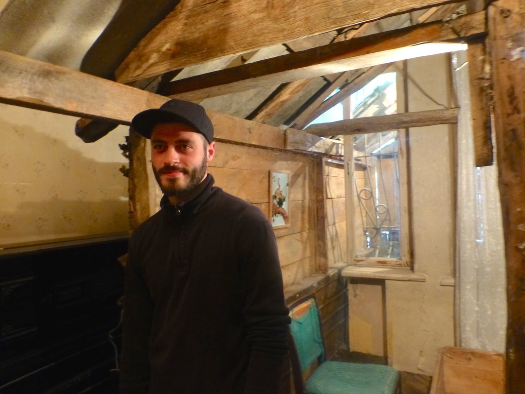 Artist Nika Kutateladze with his Kunsthalle Tbilisi commission, Watermill on Former Pavlov Street.