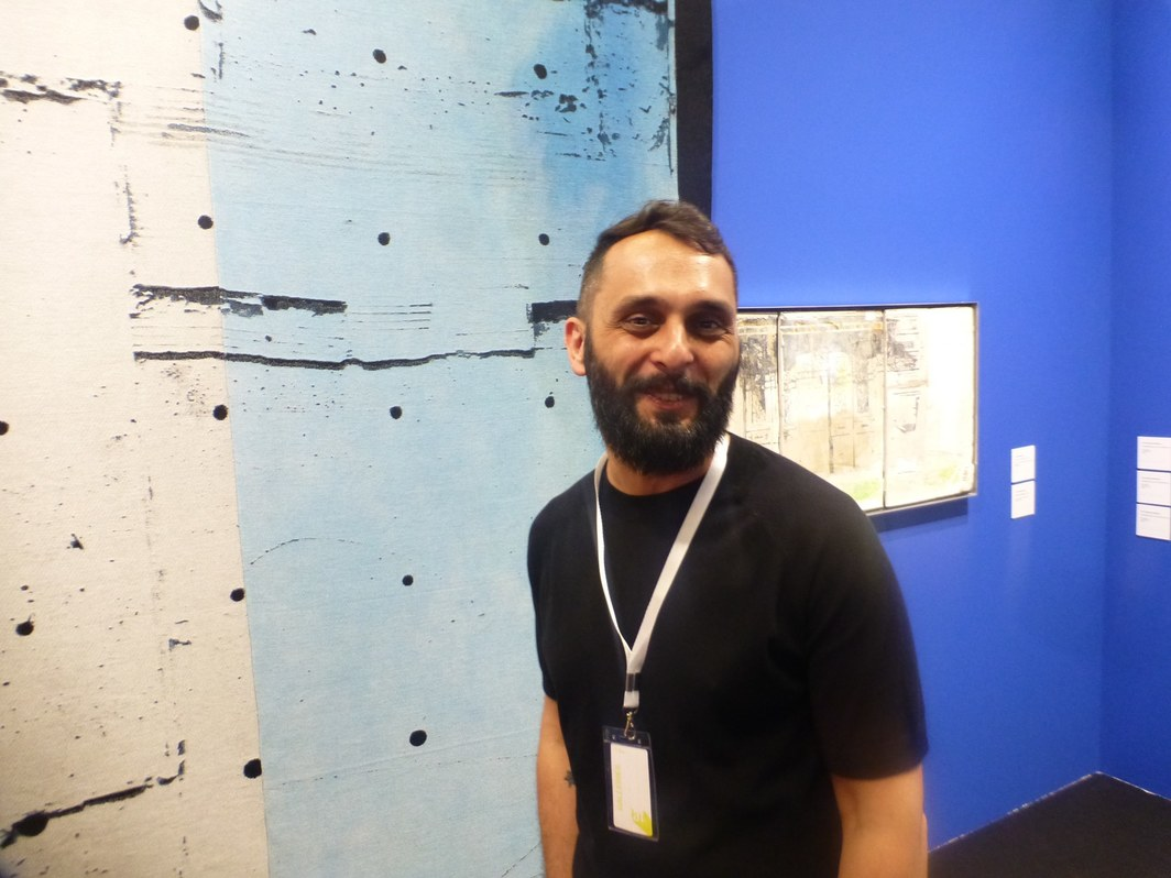 Artist Levan Mindiashvili at the Tbilisi Art Fair.