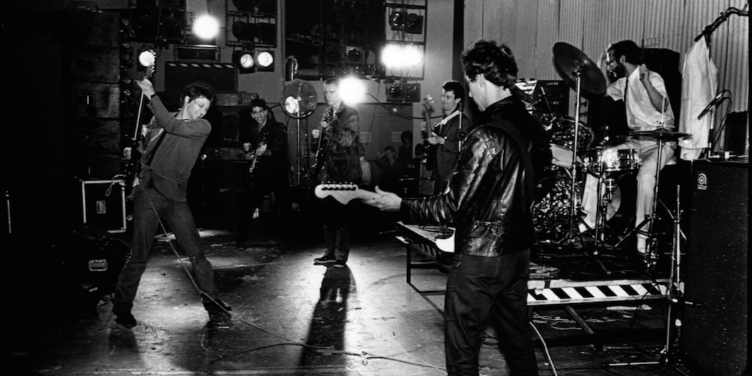 Glenn Branca performing The Ascension at Bonds International Casino, New York City, in 1981. Left to right: Glenn Branca, Lee Ranaldo, Ned Sublette, Jeffrey Glenn, David Rosenbloom, Stefan Wischerth. Photo: Paula Court.