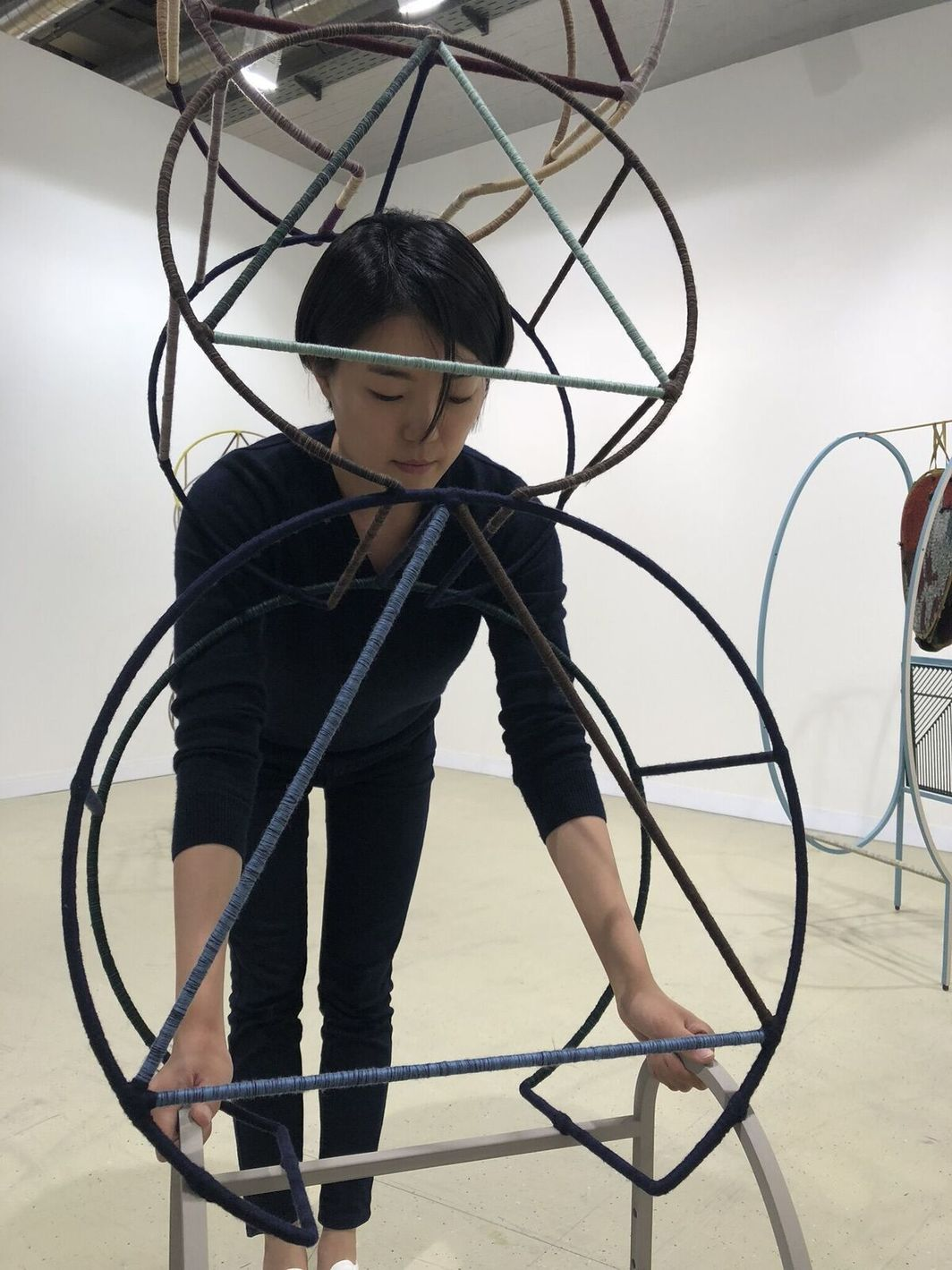 Dealer Meene An with interactive sculpture by Suki Seokyeong Kang.