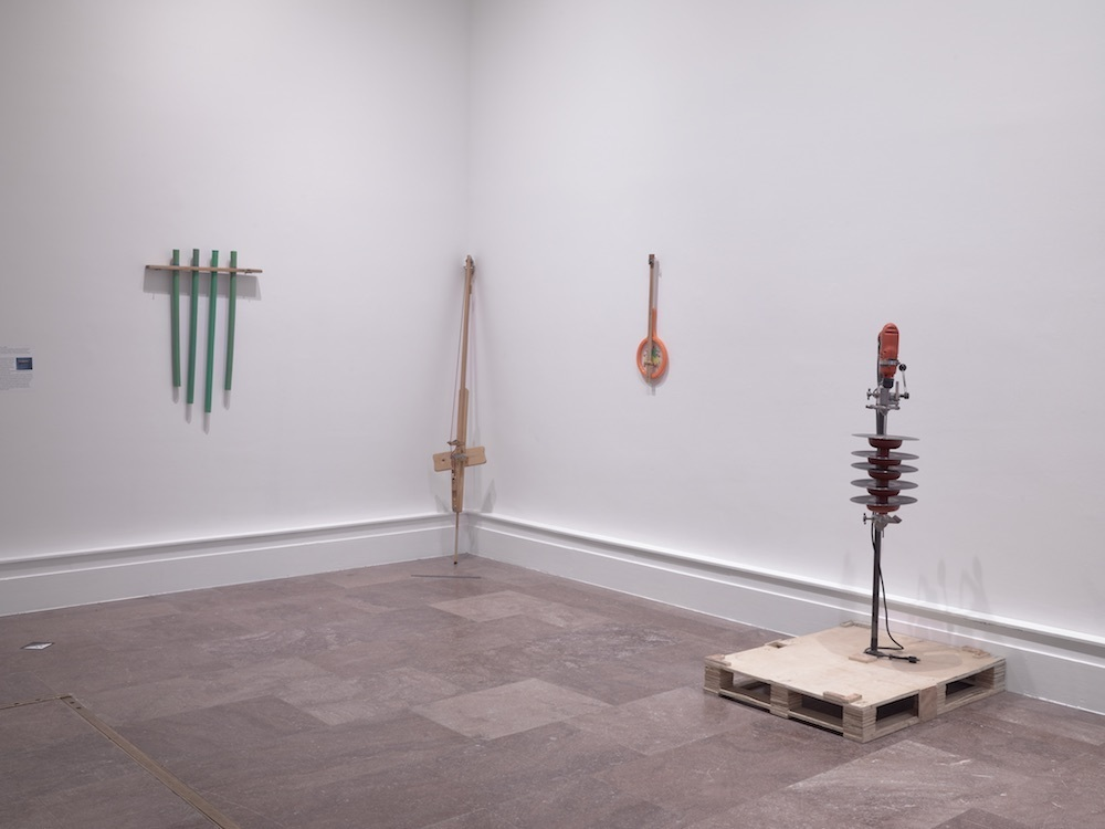 Tony Conrad, Golf Club Sleeve Chimes, ca. 1983, Electric Bass, ca. 1996, Hairstring, ca. 2009, and Phonarmonica, 2003. Installation view, Albright-Knox Art Gallery, Buffalo, New York, 2018. Photo: Tom Loonan and Brenda Bieger.