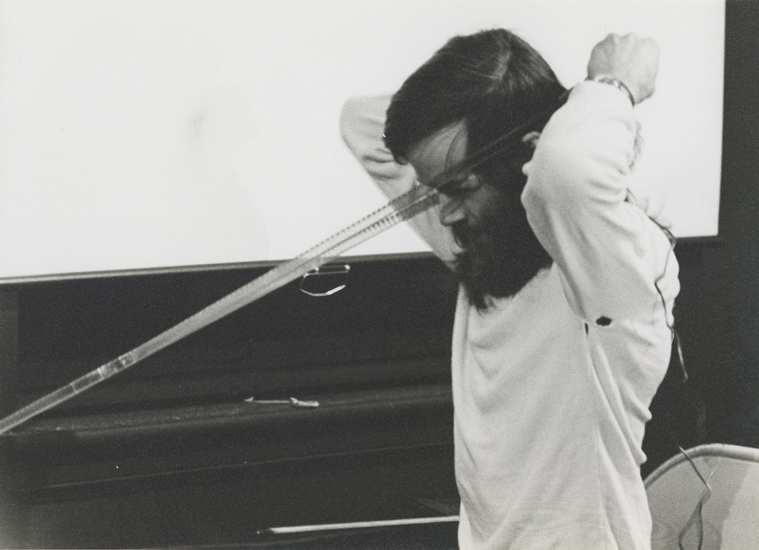 Tony Conrad performing Bowed Film, 1974. Photo: Tony Conrad Archives.