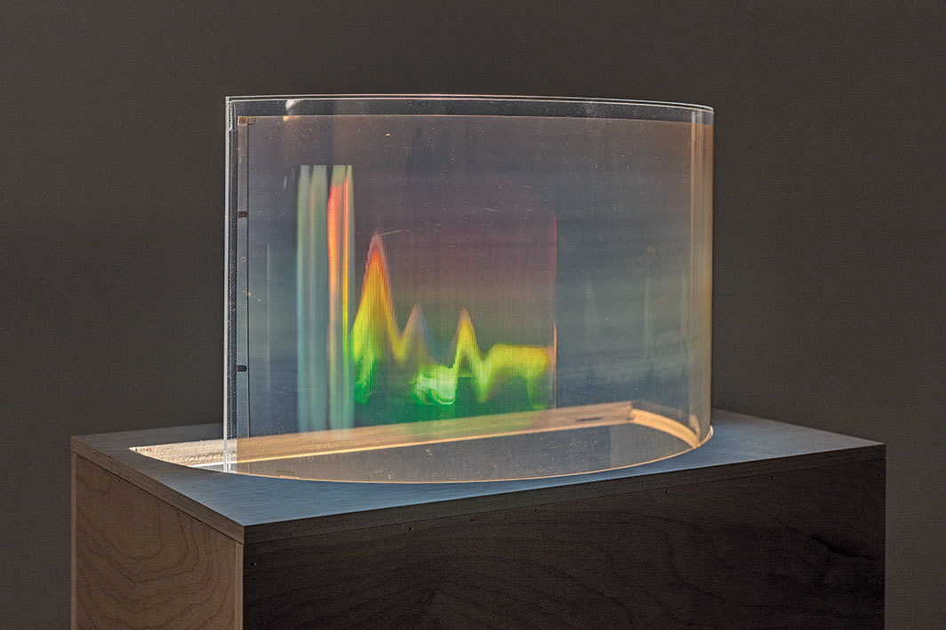 "Simone Forti, Big Jump on Back, ca. 1976, holographic film, Mylar, Plexiglas, halogen light-bulb, wood, steel tubing, electrical power cord, 56 3⁄4 × 20 × 13""."