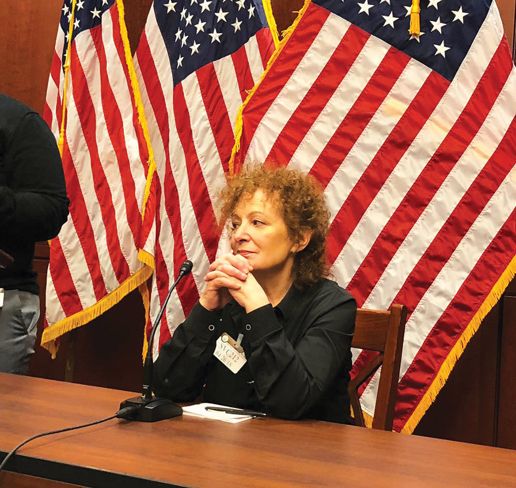 *Nan Goldin at a press conference for the Comprehensive Addiction Resources Emergency Act, Washington, DC,
