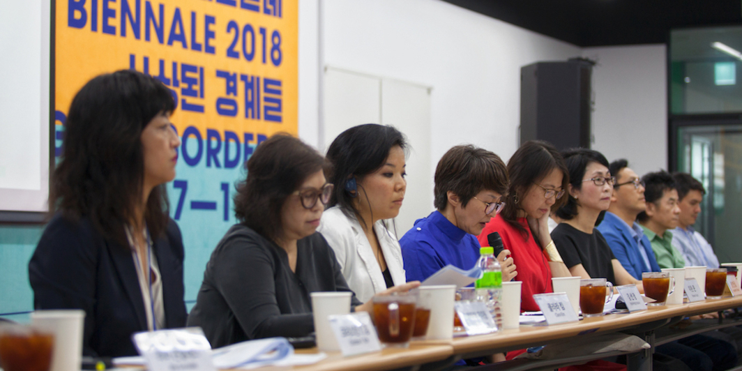 Curators discuss the 12th Gwangju Biennale at a press conference.