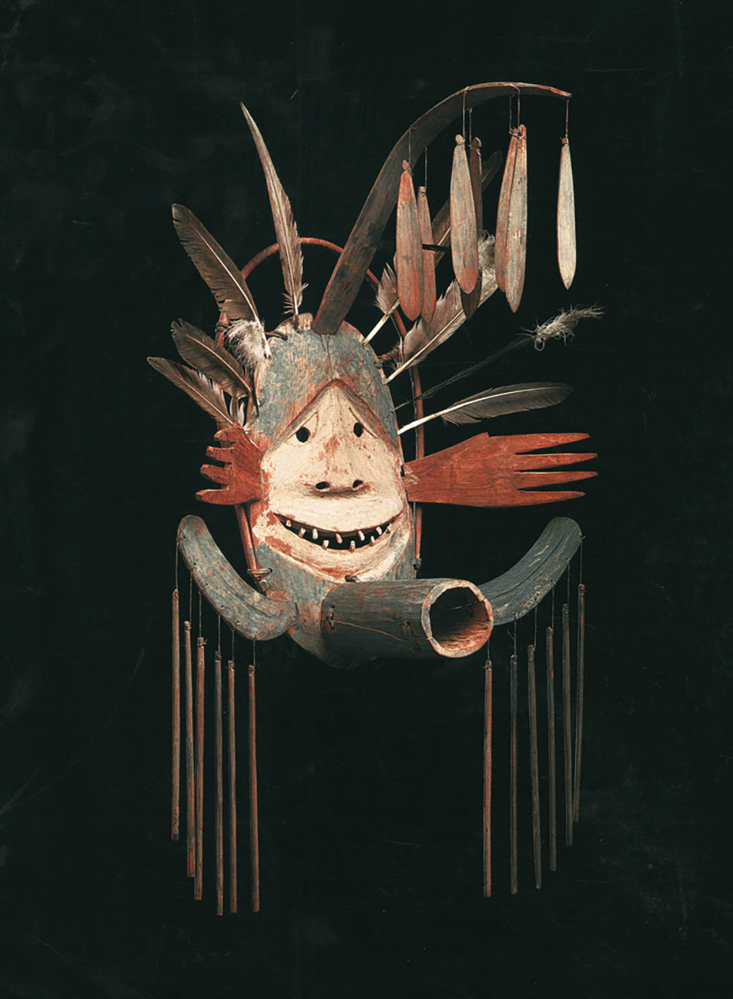 "Yup'ik people, Complex Mask, ca. 1890–1905, wood, paint, sinew, vegetal fiber, cotton thread, feathers, 34 1⁄4 × 22 × 19 1⁄4"". From ""Moon Dancers: Yup'ik Masks and the Surrealists."""
