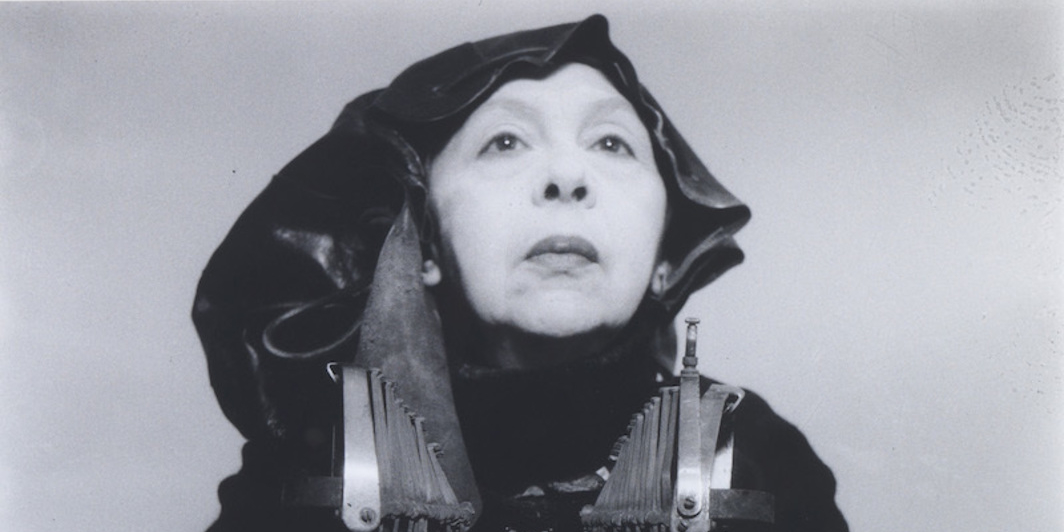 "Geta Brătescu, Mrs Oliver in her traveling costume, 1980/2012, black-and-white photograph, 15 x 15.5"". Courtesy the artist, Galerie Barbara Weiss, Berlin, and Ivan Gallery."
