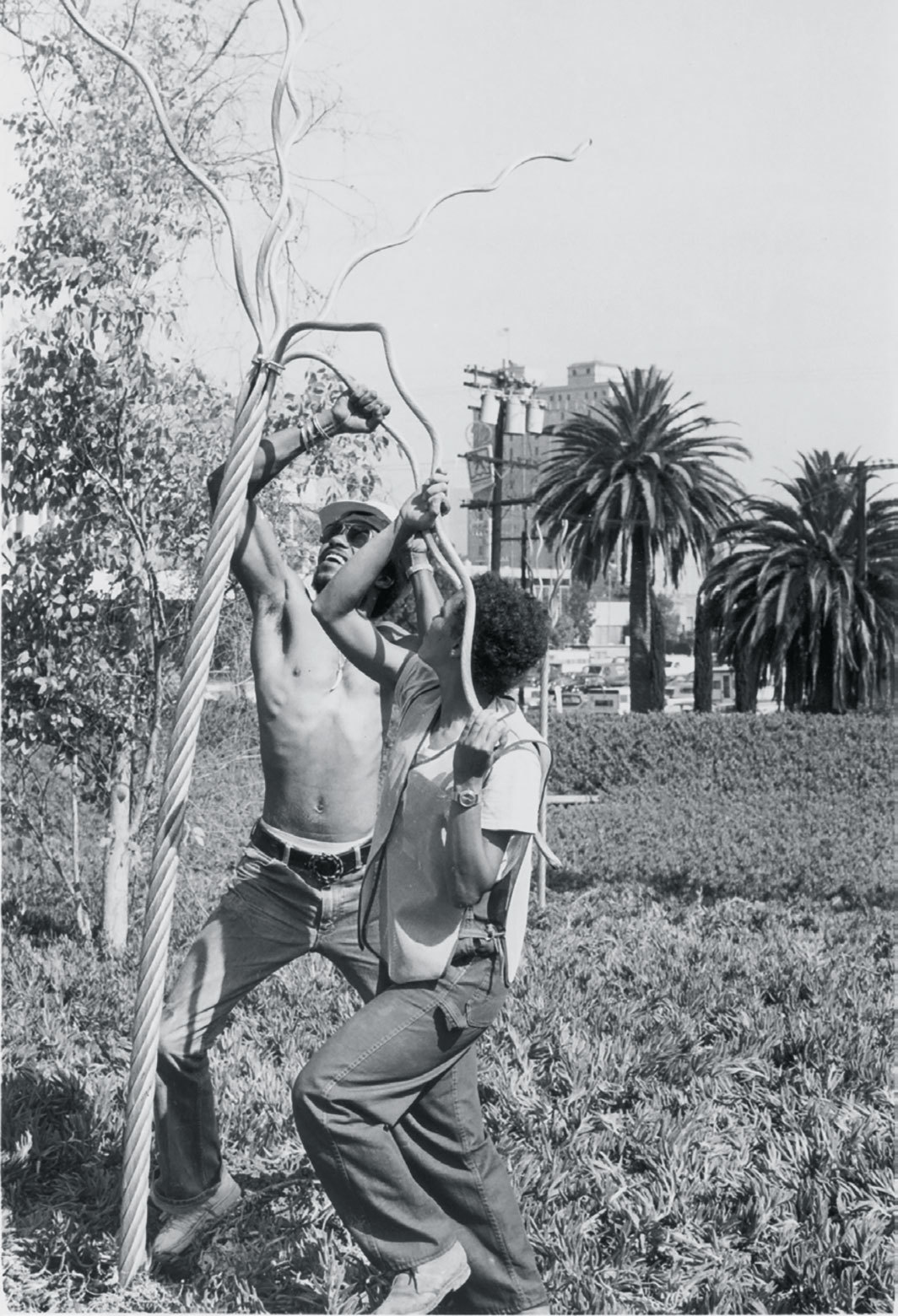 Maren Hassinger installing Twelve Trees #1, 1978, Los Angeles, 1978. Photo: Adam Avila.