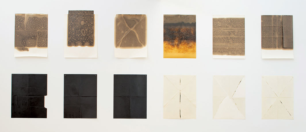 "Dorothea Rockburne, ""Ineinander Series,"" 1972, crude oil and tar on twelve paper sheets, each 40 × 30"". Photo: Bill Jacobson Studio."
