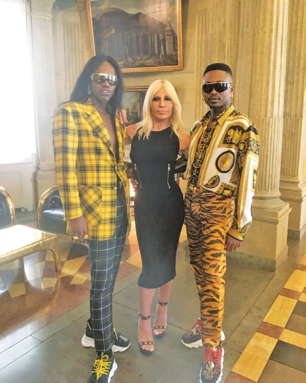 *FAKA with Donatella Versace backstage at the Versace Spring/Summer 2019 menswear show, Milan, June 16, 2018.*