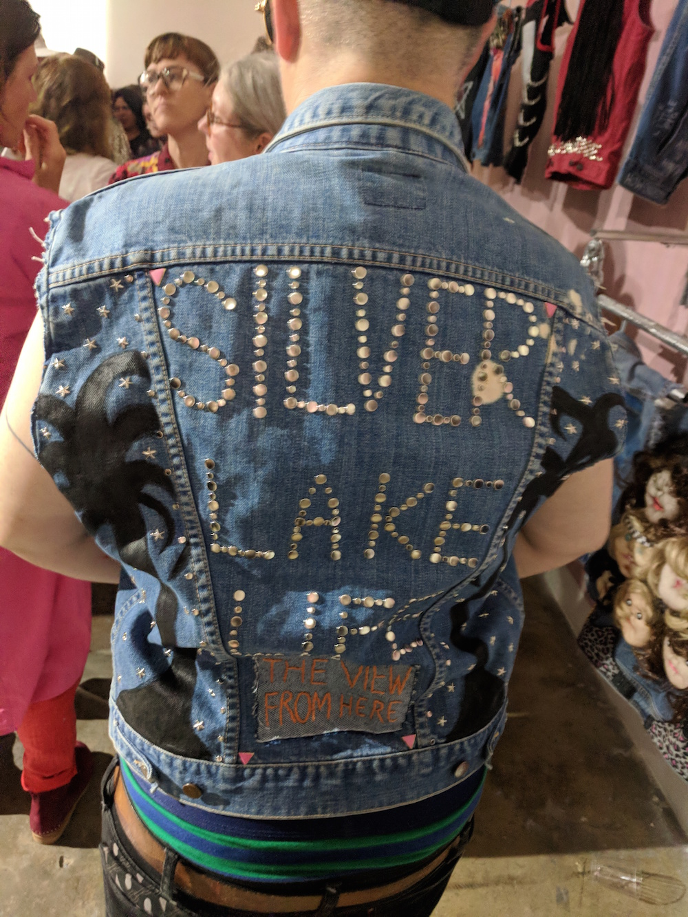Samara Halperin wearing a vest honoring Tom Joslin and Mark Massi's documentary Silverlake Life: The View From Here (1993).