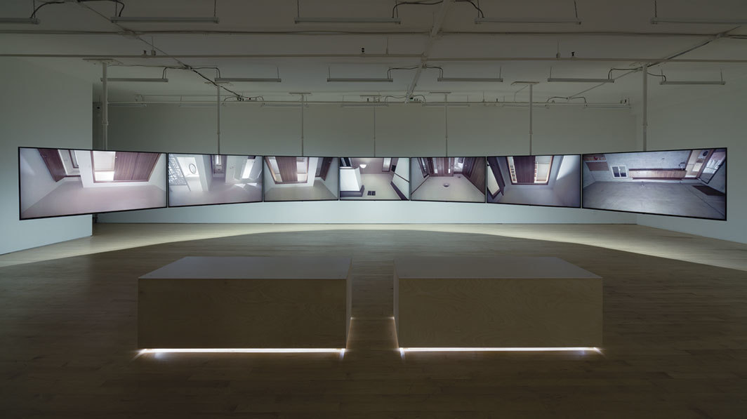 Glen Fogel, With You . . . Me, 2014–18, seven-channel synchronized video (color, sound, 12 minutes 40 seconds), LED lighting, solid-state relay, custom benches. Photo: Charles Benton.