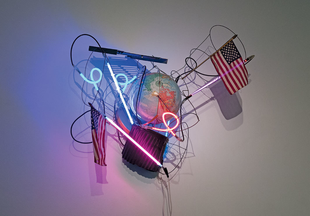 "Keith Sonnier, USA: War of the Worlds, 2004, neon tubing, transformer, found objects, approx. 48 × 48 × 28""."