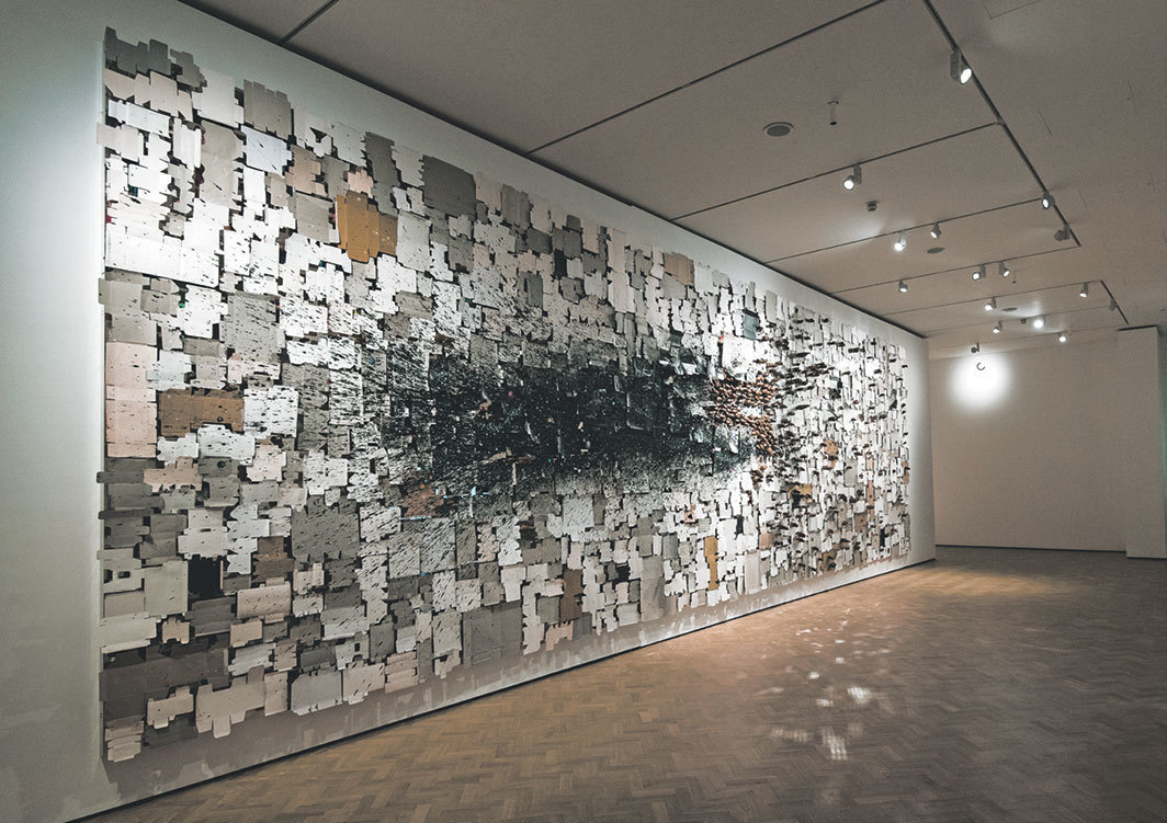 N. S. Harsha, Reclaiming the Inner Space, 2017, aluminum composite panel mirror, aluminum, acrylic paint, carved teak wood elephants, found cartons, steel hooks, pellets. Installation view. Photo: Polly Thomas.