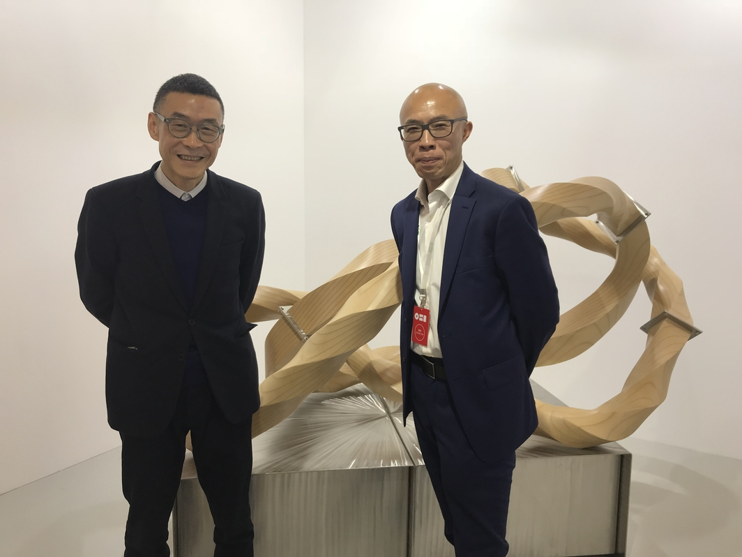 Artist Wang Jianwei and gallerist Lu Jie.