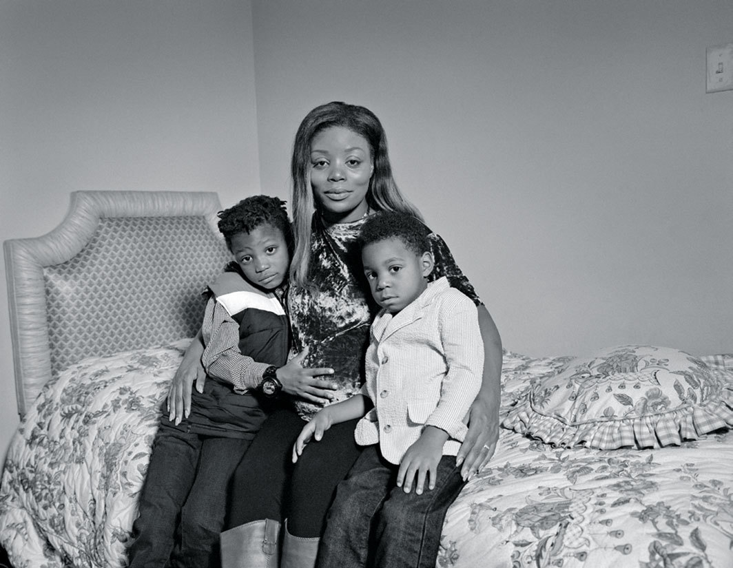 LaToya Ruby Frazier's portrait of Simone Landrum at home with her sons, Dillon (left) and Caden, during her pregnancy, November 2017.