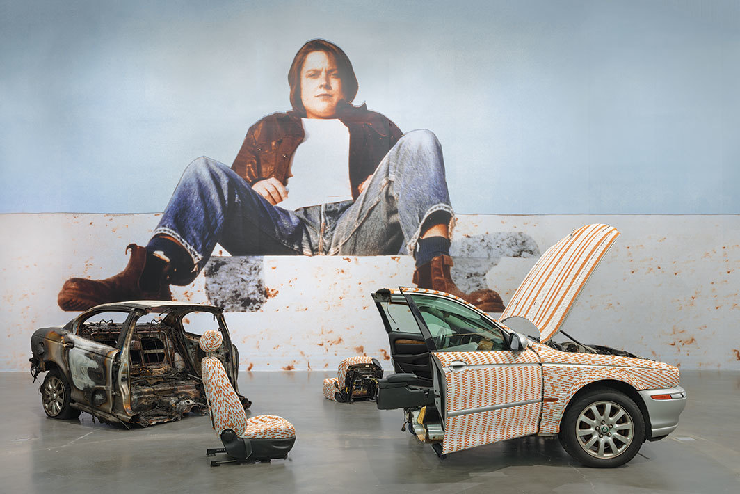 "View of ""Sarah Lucas: Au Naturel,"" 2018, New Museum, New York. Wall: Divine, 1991/2018. Floor: This Jaguar's Going to Heaven, 2018. Photo: Maris Hutchinson."