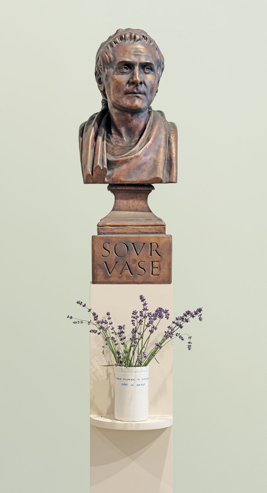 "Ian Hamilton Finlay, ROUSSEAU (Sour Vase)/A Wild Flower Is Ideological, like a Badge, 1991–93, cast bronze, ceramic vase; bust: 27 1⁄2 × 10 1⁄2 × 11"", vase: 5 1⁄2 × 3 3⁄8 × 3 3⁄8""."