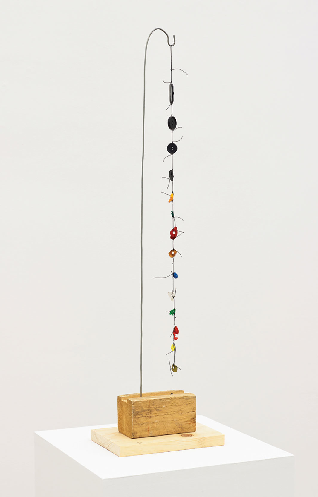"B. Wurtz, Untitled, 2018, wood, string, buttons, acrylic paint, wire, 30 × 8 × 5 1⁄2""."