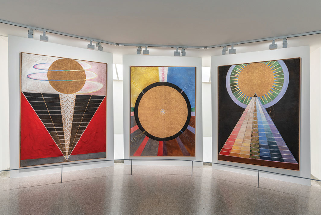 "View of ""Hilma af Klint,"" 2018–19. From left: Group X, No. 2, Altarpiece, 1915; Group X, No. 3, Altarpiece, 1915; Group X, No. 1, Altarpiece, 1915. Photo: David Heald."