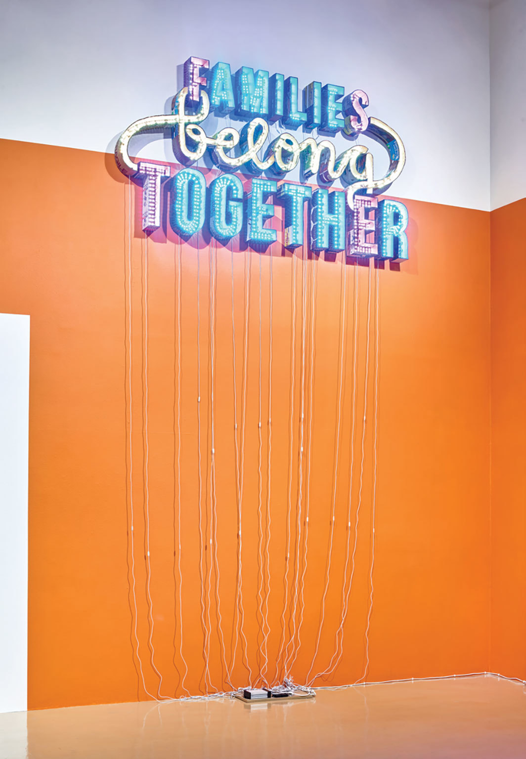 "Andrea Bowers, Families Belong Together, 2018, cardboard, LED lights, 59 × 110 × 6"".  From ""After Posada: Revolution."""