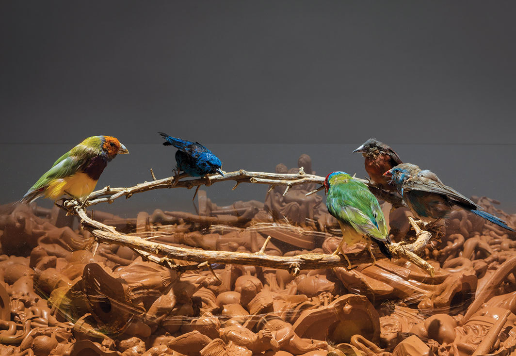 "*Hayley Silverman, _Assimilation_ (detail), 2018,* plastic religious figures, taxidermy birds, wooden wreath, 50 × 38 × 38""."