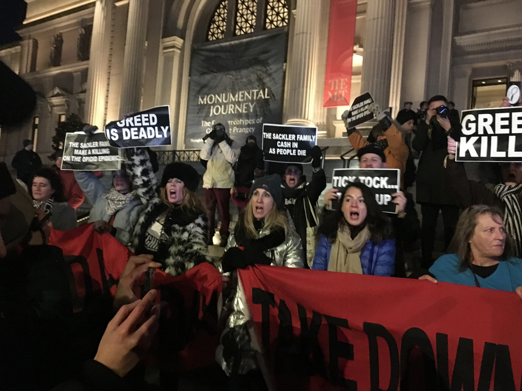 Demonstrators at a rally on the steps of the Metropolitan Museum of Art following the Guggenheim protest on Saturday.