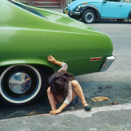 Helen Levitt, Girl Playing Under Green Car, New York City, 1970.