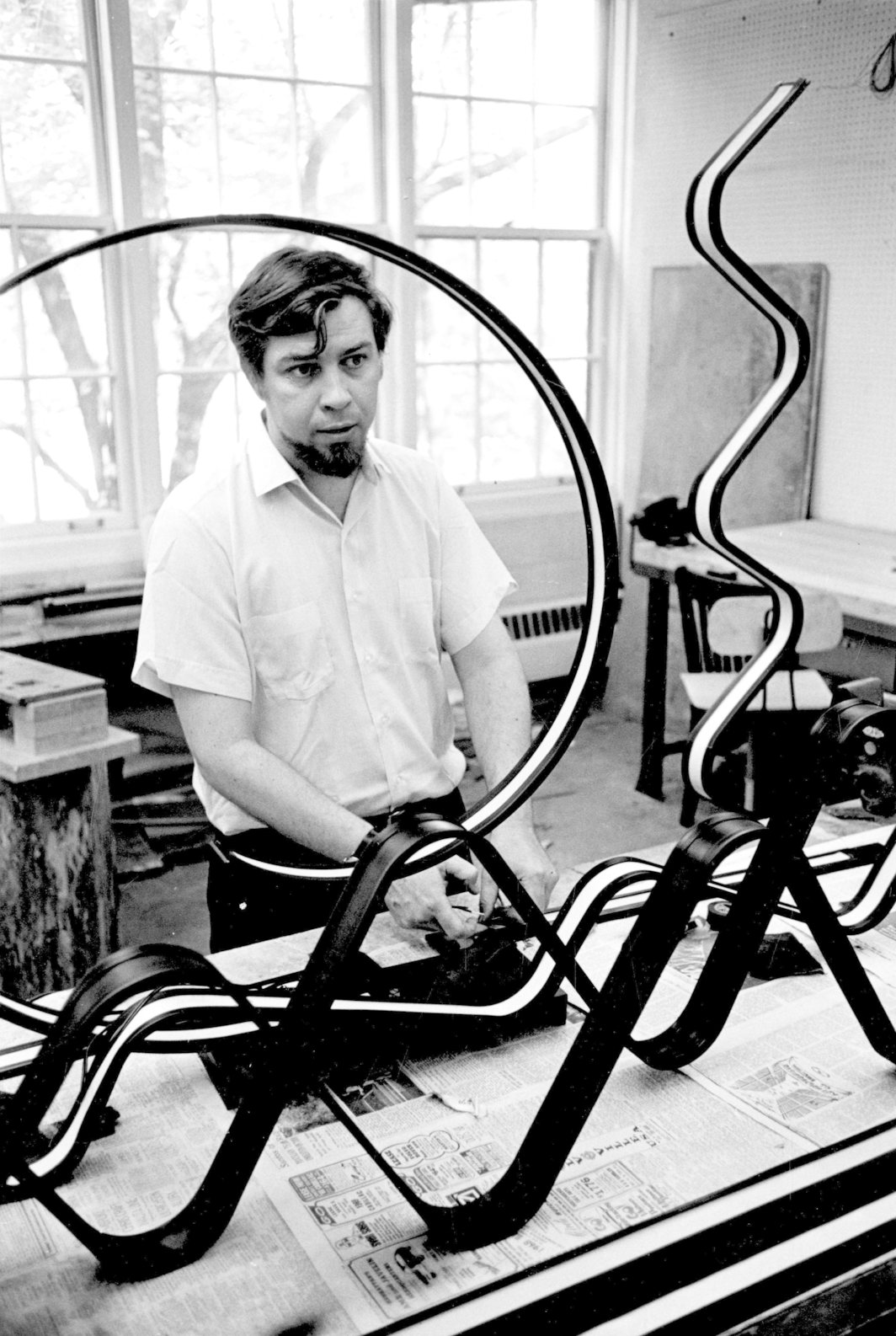 Jack Burnham working on one of his viewer-activated luminous ribbon pieces, 1982. Photo: Northwestern University archives.