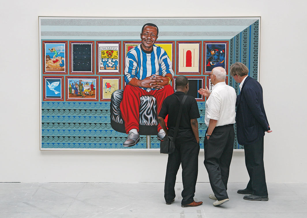 Curator Robert Storr (right) with artists Chéri Samba and Ellsworth Kelly viewing Samba's 2002 painting Aussi . . . au plafond (Also . . . on the Ceiling), Italian Pavilion, Fifty-second Venice Biennale, 2007. Photo: Jack Shear.