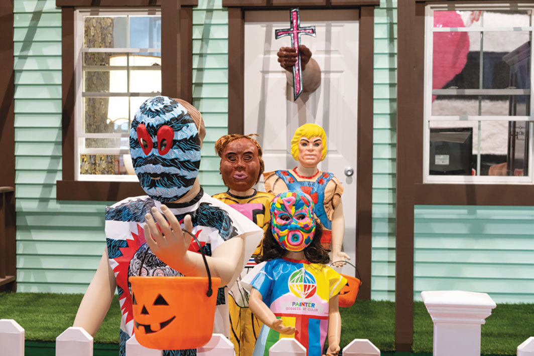 "View of ""Trenton Doyle Hancock: Mind of the Mound: Critical Mass,"" 2019, MASS MoCA, North Adams, MA. Background: Halloween House, 2019. Foreground: Moundverse Halloween Costumes, 2017. Photo: Kaelan Burkett."