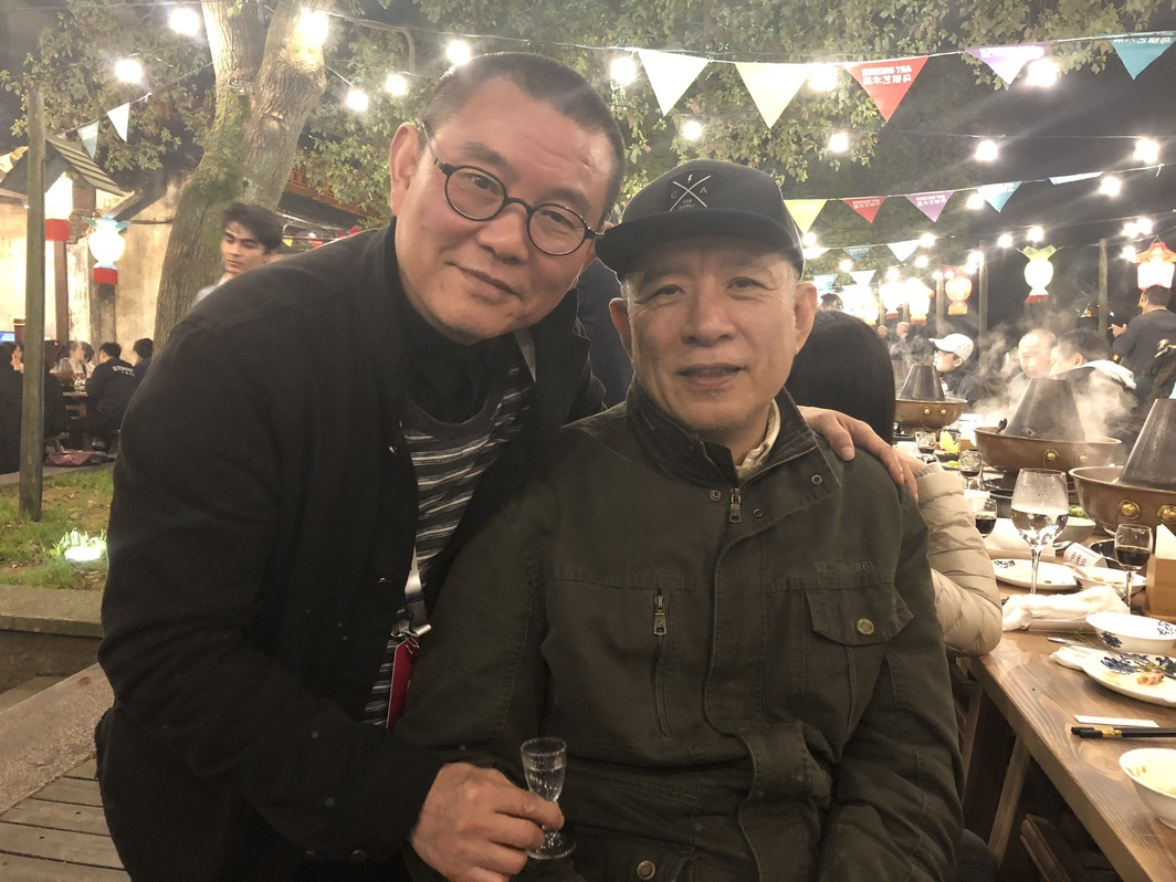 Hubei Art Museum director Fu Zhongwang and artist Xu Tan.