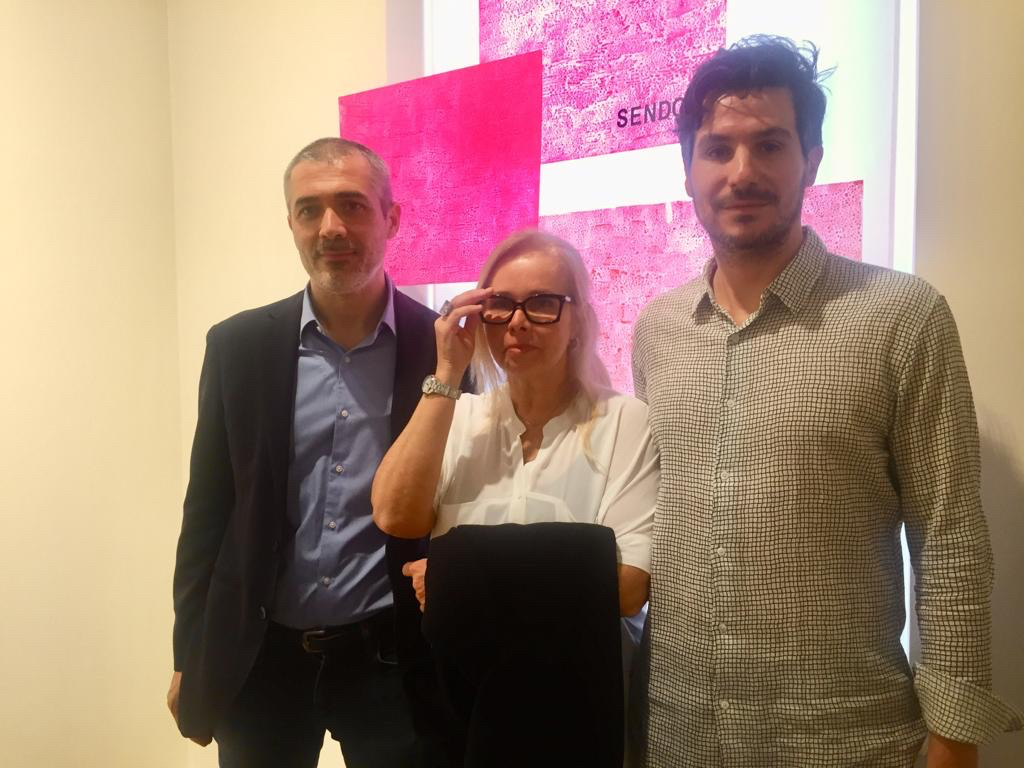 Curator Francesco Stocchi, Paola Pape, and António Leal at Fondazione Carriero.