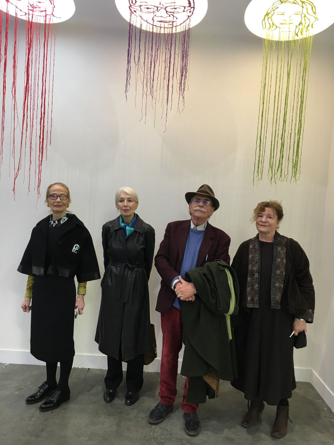 Gallerist Luisa Delle Piane with design historian and critic Cristina Morozzi, architect and artist Ugo la Pietra, and Aurelia La Pietra under a project by Campana Brothers.