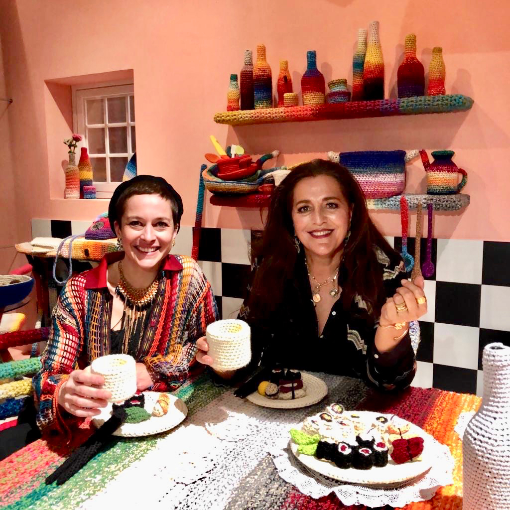 Alessandra Roveda, artist, and Angela Missoni, creative director and president of Missoni, sitting in Home Sweet Home by A. Roveda.