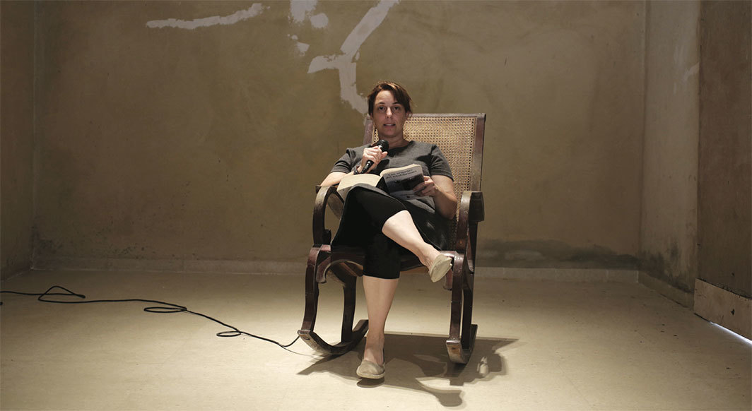 Tania Bruguera reads from Hannah Arendt's 1951 The Origins of Totalitarianism in her home, Havana, May 20, 2015. Photo: Enrique de la Osa.