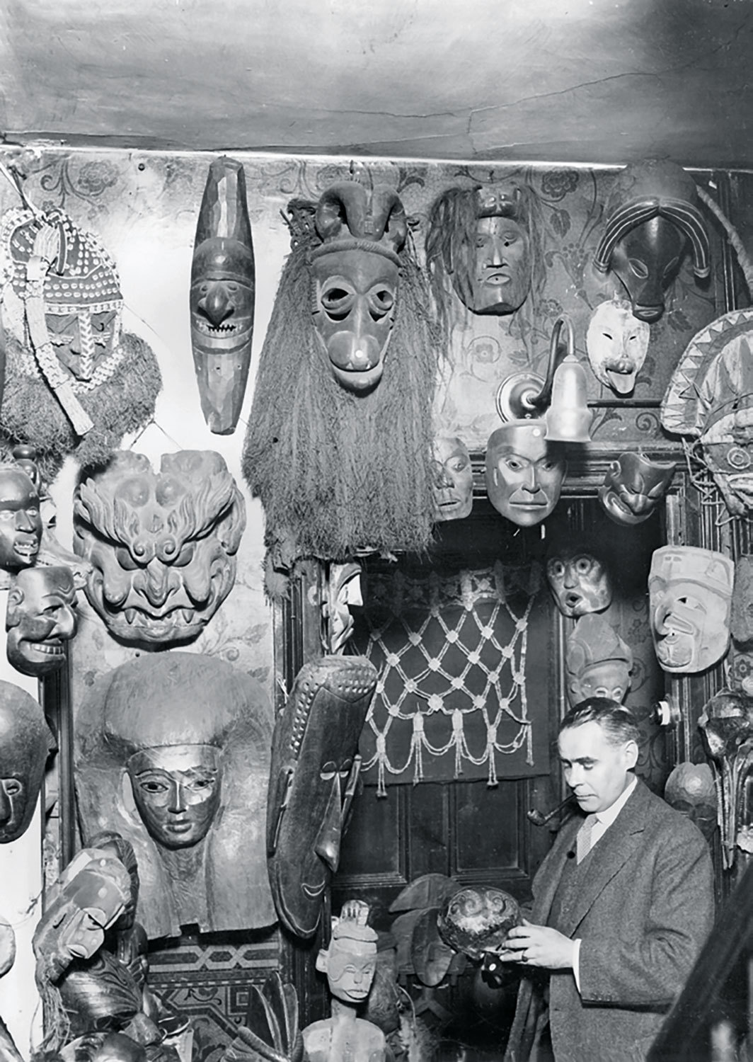 W. O. Oldman with masks and headdresses, ca. 1920. Photo: Pacific and Atlantic Photos Ltd.