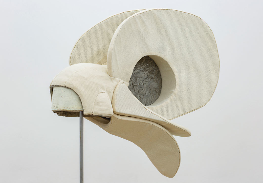 "Annie Ratti, White Bird's Hat, 2018, fabric, styrene rubber, metal mesh, wooden block, metal stand, 81 1⁄8 × 29 1⁄8 × 9 7⁄8""."
