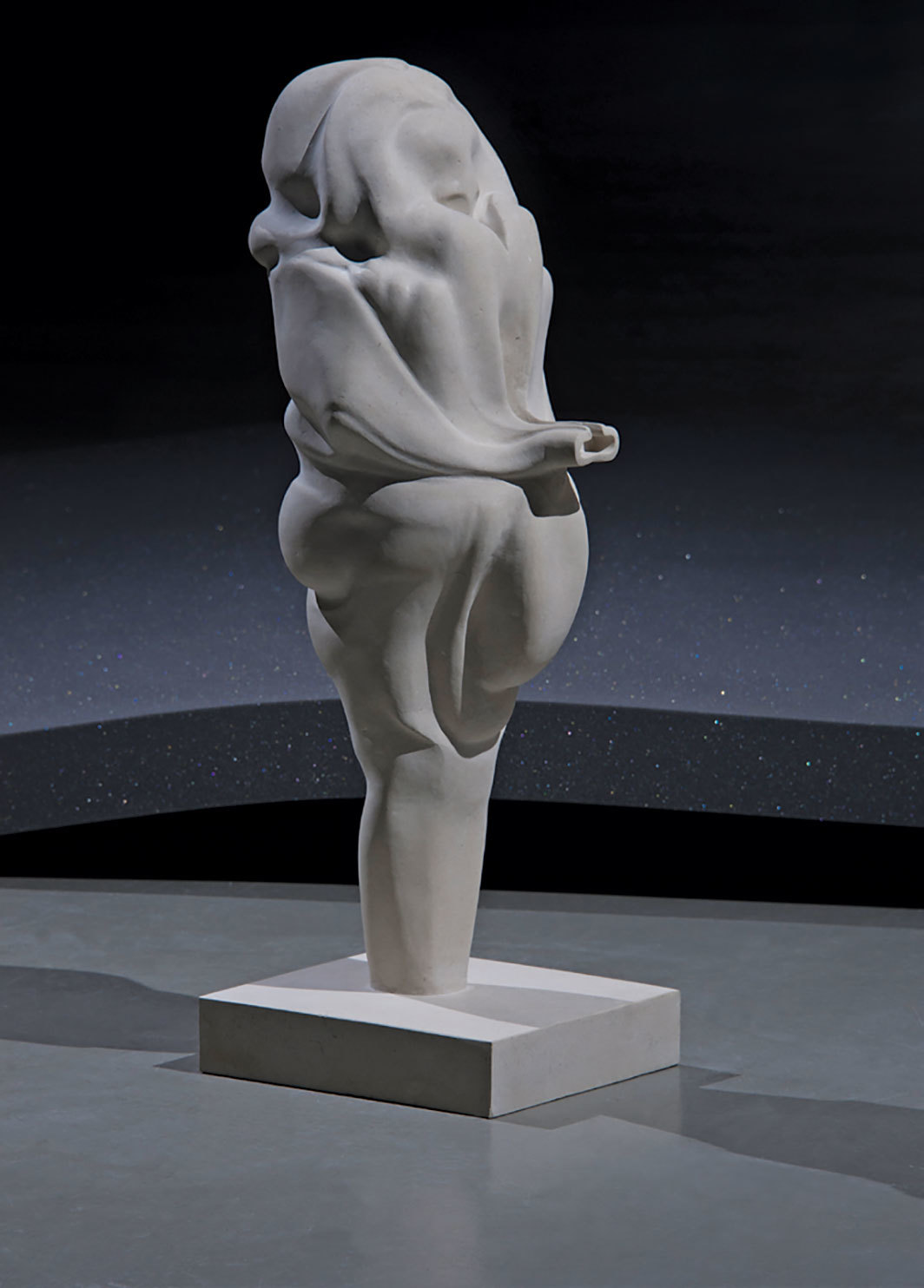 "Marguerite Humeau, Venus of Frasassi, a 10-year-old female human has ingested a rabbit's brain, 2018, Portland stone, sound, 31 1⁄2 × 12 3⁄4 × 11""."