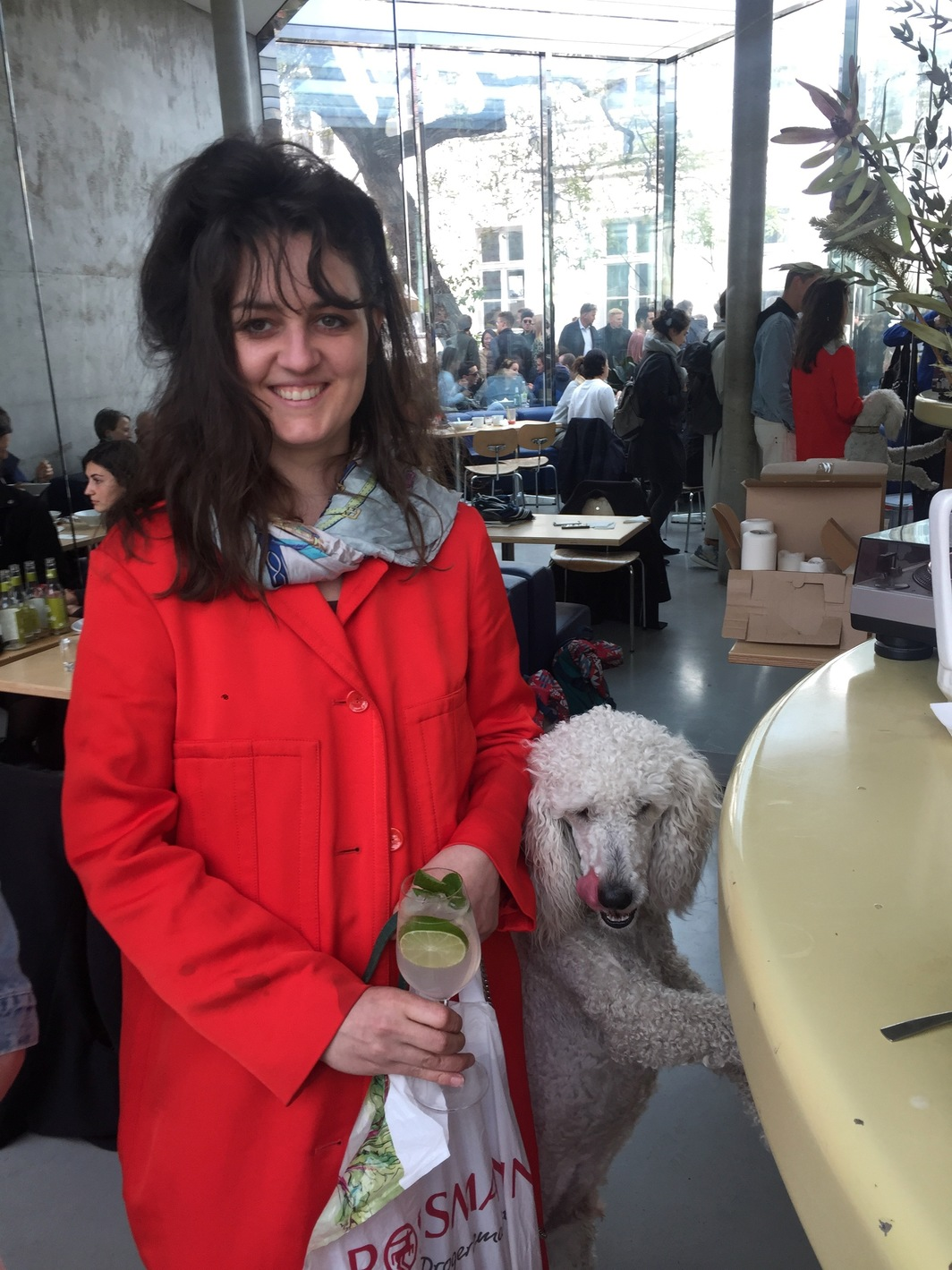 Raphaela Vogel, artist, with poodle Rollo.